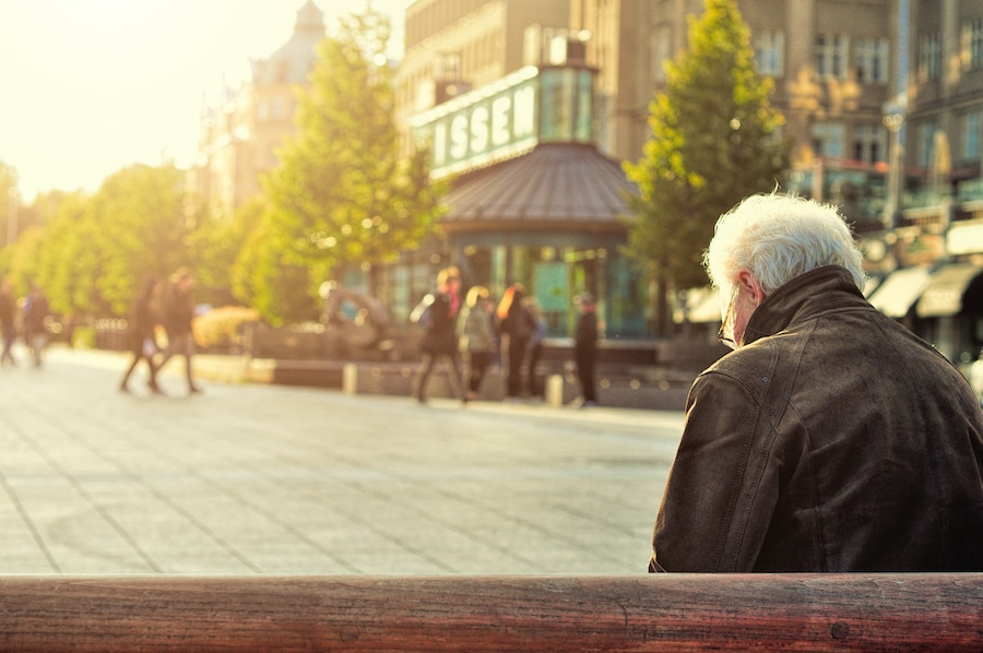 senior citizen sitting on bench