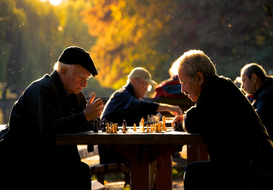 seniors playing chess outside